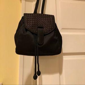 Ladies black satin Bottega Veneta backpack.